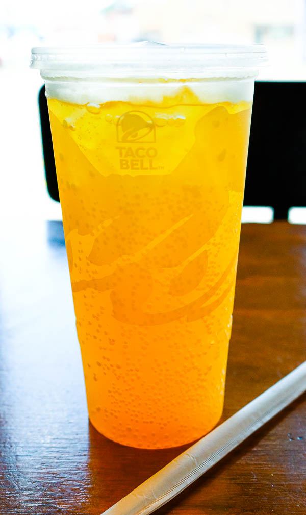 Taco Bell cup with orange drink