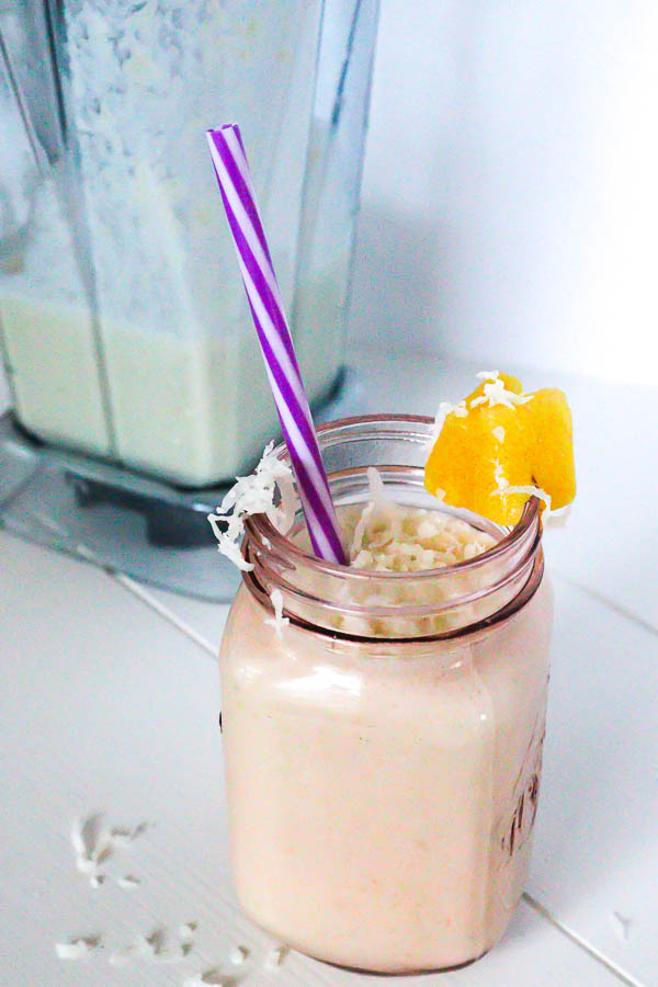 Healthy Pina Colada Chia Pudding in glass jar blended as a smoothie