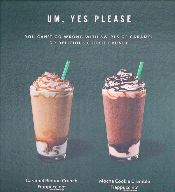 sign at Starbucks with 2 drinks